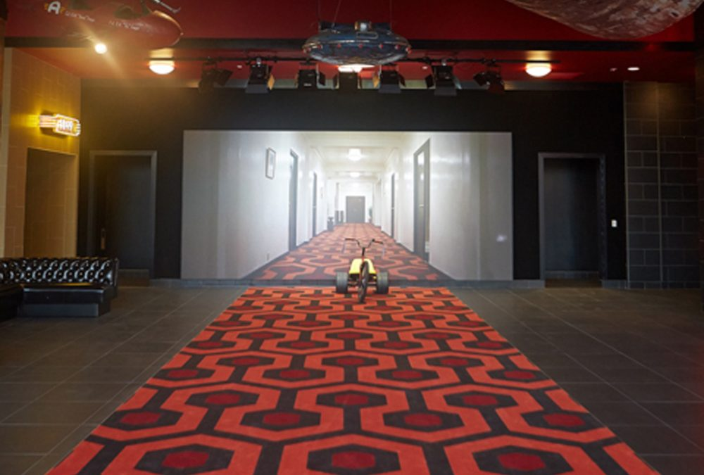 Alamo South Lamar Lobby with Shining Carpet and Tricycle